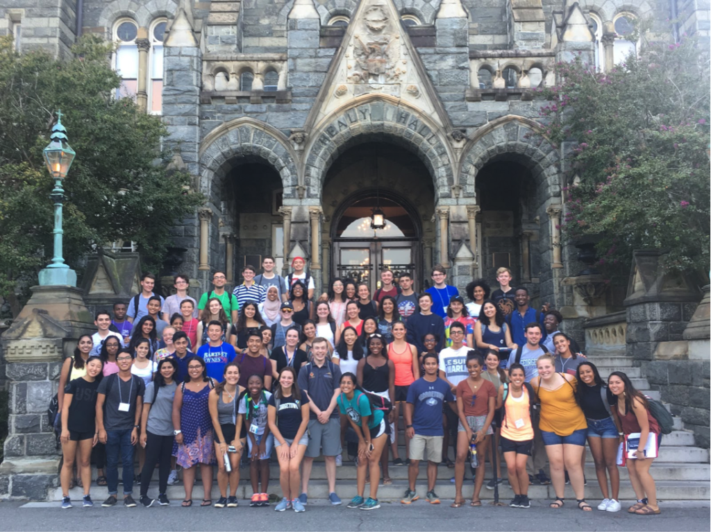 FOCI participant gather on the steps of Healy Hall for a group photo.