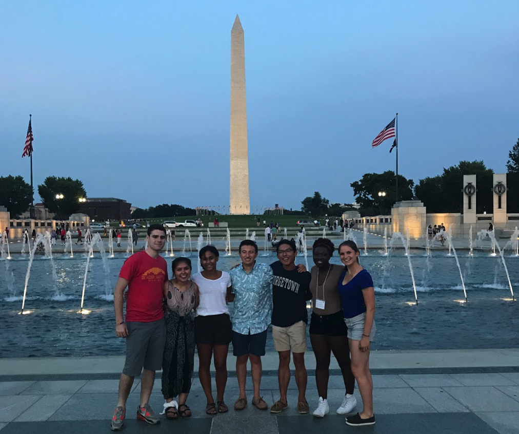 FOCI participants stand in front of the Washington monument during sunset.
