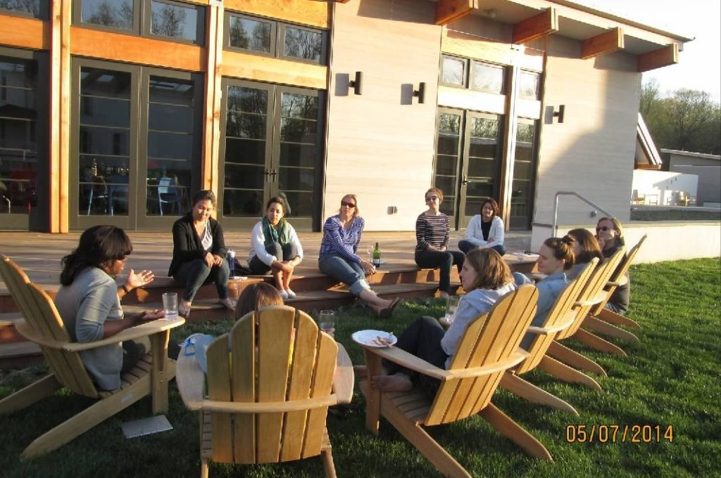 Professor Sabrina Wesley-Nero (far left) leads the CSJ team in a dialogue at Georgetown's Calcagnini Retreat Center in Virginia
