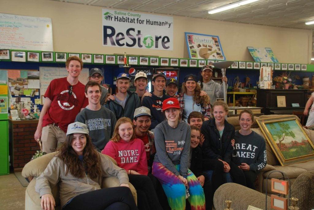 Marlene Canlas, Assistant Dean of Georgetown College (top right), on an Alternative Spring Break trip to Benton, Arkansas