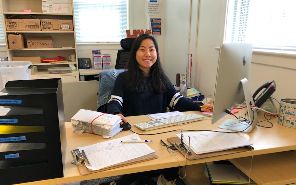 COI Abigail Austria (C'22) working at CSJ front desk